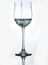Wineglass water splashing in a Royalty Free Stock Photography
