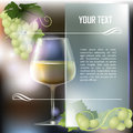 Wineglass of white wine and grapes