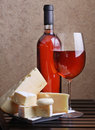 Wineglass, wine and cheese Royalty Free Stock Image