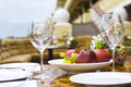 Wineglasses and fruits on a table close up outdoor shot Royalty Free Stock Photos