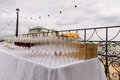 stock image of  Wineglasses for the wedding catering on the table outdoors