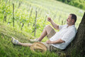 Winemaker drinks white wine tasting a glass in the vineyard Stock Image