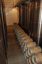 Winery tanks and barrels of brandy in wine cellar Royalty Free Stock Image