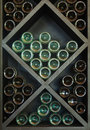 Wines on wine rack bottles in cellar Royalty Free Stock Images