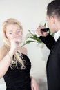 Winetasting a young attractive couple at winetesting Royalty Free Stock Photography