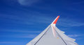 Wing of airplane with the blue sky Royalty Free Stock Photo