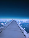 Wing of airplane fly over the blue sky and white cloud Royalty Free Stock Photo