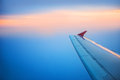 Wing of airplane flying in the sky Royalty Free Stock Photo