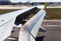 Wing of an airplane with landing flaps a extended Royalty Free Stock Images