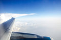 Wing of plane with blue sky and white clouds Royalty Free Stock Photos