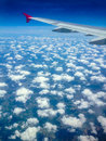 Wing of a plane and clouds white fluffy Stock Photo