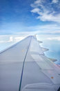Wing of plane view s from inside window cabin while is on flight Stock Photos