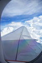 Wing of plane view s from inside window cabin while is on flight noise might viewable by high iso Stock Image