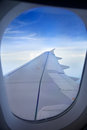Wing of plane view s from inside window cabin while is on flight noise might viewable by high iso Stock Photography