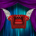 Winged comfort chair and curtains Stock Photography