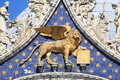 Winged lion of venice symbol on the facade st mark cathedral italy Royalty Free Stock Photos