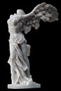 Winged victory of samothrace small replica isolated on black background Royalty Free Stock Image