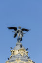 Winged women on top of building statue in spain Royalty Free Stock Photo