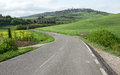 Winging road and town of Pienza Royalty Free Stock Image