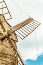 Wings closeup of wooden flour windmill Royalty Free Stock Photo