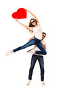 On the wings of love happy young people in posing with big red heart isolated over white Stock Photography