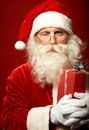 Winking photo of funny santa claus with one eye closed looking at camera Stock Photos