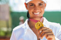 Winner female tennis player with a golden medal Stock Photo