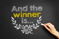 And the winner is hand writes on blackboard Royalty Free Stock Image
