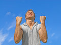 The winner, happy energetic young man Royalty Free Stock Photo
