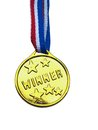 Winner medal golden color toy close up Stock Photos