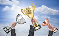 Winners holding champion golden silver and bronze trophies Royalty Free Stock Photo