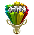 Winning attitude gold trophy stars fireworks good vision the words in a with colorful and shooting around it to illustrate the Royalty Free Stock Photography