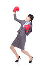 Winning business woman wearing boxing gloves Royalty Free Stock Photo
