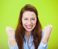 Winning closeup portrait of young woman happy ecstatic celebrating being successful isolated on green background positive human Royalty Free Stock Images