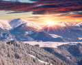 Winter alpine sunrise in mountains with dramatic sky the Stock Photos