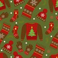 Winter apparel seamless pattern. Christmas clothes repeating texture. Warm clothing Infinite background. Sweater, gloves