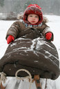 Winter baby on sled Stock Images