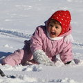 Winter baby in snow Stock Photos