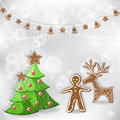 Winter background. Christmas tree and gingerbread. Stock Image