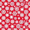 Winter background seamless pattern with red snowflakes on a white Stock Images