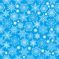 Winter background seamless pattern with white snowflakes on a blue Royalty Free Stock Images