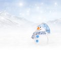Winter background with snowman a and snowflakes falling from the sky Stock Photography