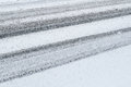 Winter background tire tracks snowy road with Royalty Free Stock Images