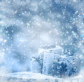 Winter background wrapped gifts wooden trunk snowing Royalty Free Stock Photo