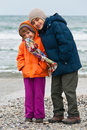 Winter on the beach girl and boy heavy wind Royalty Free Stock Images