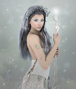 Winter beauty beautiful fantasy womany with scepter and crown Royalty Free Stock Image