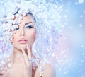 Winter beauty beautiful fashion model girl with snow hair style Royalty Free Stock Photos