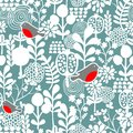 Winter birds and frozen flowers seamless pattern.