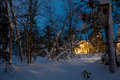 Winter blue night Landscape, warm wooden house Royalty Free Stock Photo