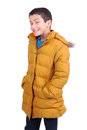 Winter boy posing in colorful coat isolated in white Royalty Free Stock Photos